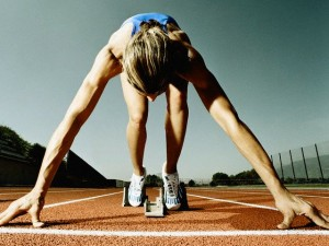 Runner Crouching at Starting Line
